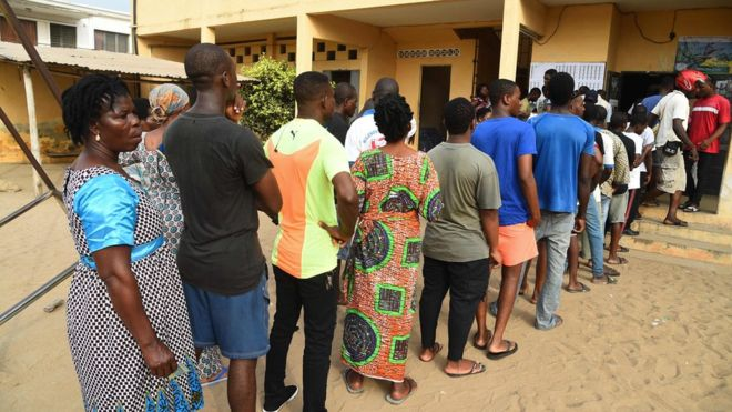 People queue to vote at a polling station in Lome, on February 22, 2020, during the presidential elections.